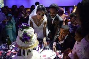 couple cutting a cake at their wedding at infinity park event center