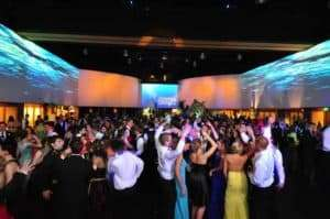 Groups dancing together at a prom