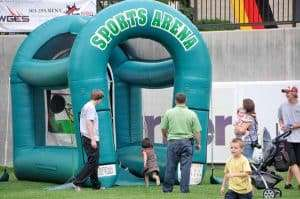 bouncy castles set up for an outdoor event at Infinity Park