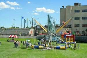 Outdoor event with a lot of fun things for kids at the stadium in Infinity Park