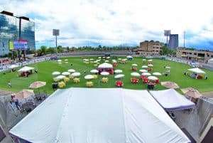 Tables set up on in the stadium for an outdoor event at Infinity Park